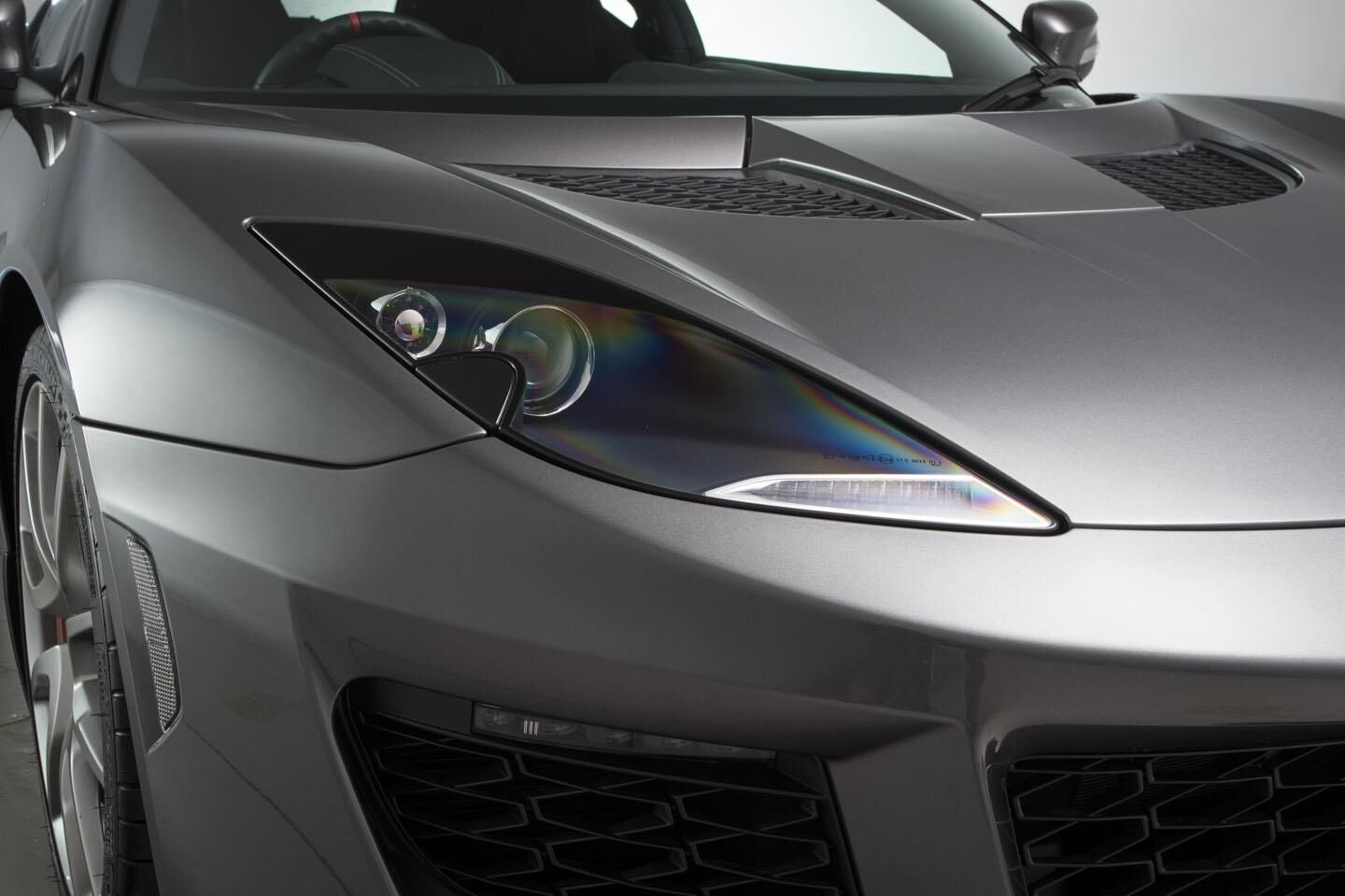 Lotus Evora featuring headlights and rear lights designed and manufactured by Lite-wire